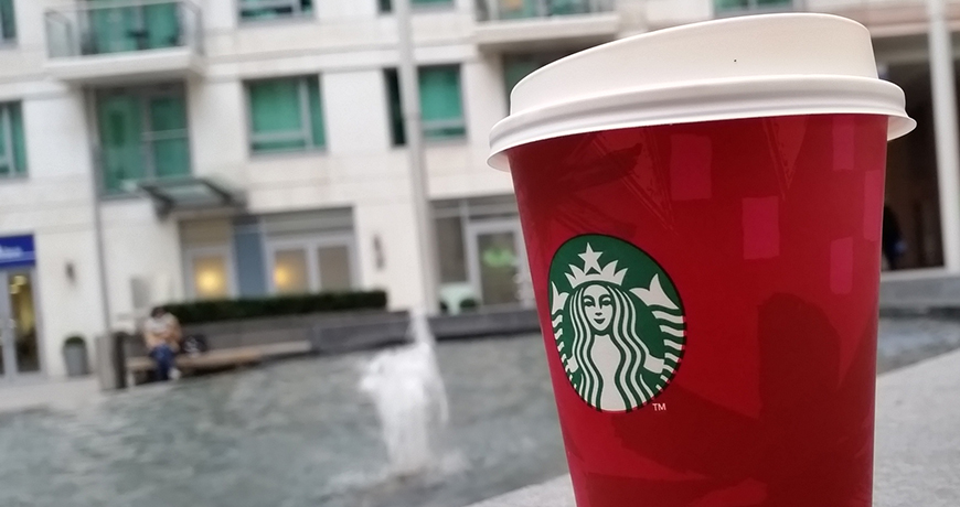 Holiday Spice Flat White in a Red Cup